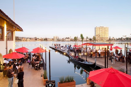Enjoy a meal on the patio at Lake Chalet Seafood Bar & Grill, one of GAYOT's Best Outdoor Dining Restaurants in San Francisco's East Bay