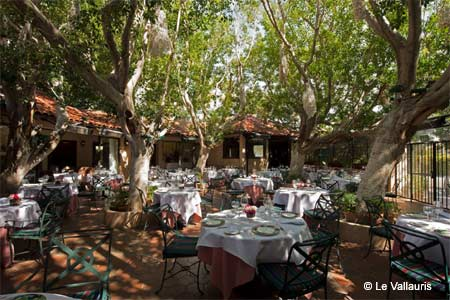 The romantic patio at Le Vallauris, one of GAYOT's Best Outdoor Dining Restaurants in Palm Springs