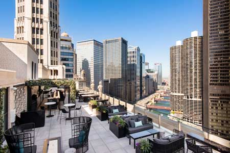 Enjoy a meal on the patio at LH Rooftop, one of GAYOT's Best Outdoor Dining Restaurants in Chicago