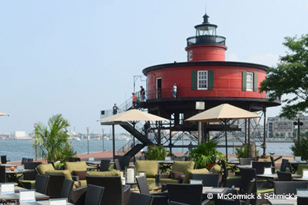 Enjoy a meal on the patio at McCormick & Schmick's Seafood & Steaks, one of GAYOT's Best Outdoor Dining Restaurants in Baltimore