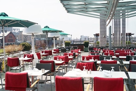 Enjoy al fresco dining on the patio that overlooks the waterfront at Miel in Boston