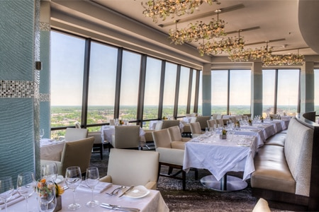 One of the Top 10 Penthouse Restaurants in the U.S., Nikolai's Roof offers stunning views of the city from the 30th floor of the Hilton Atlanta