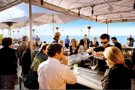Enjoy ocean views on the rooftop patio at Ocean Terrace, one of GAYOT's Best Outdoor Dining Restaurants in La Jolla, CA