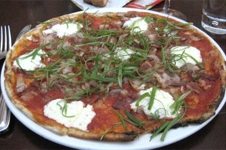 Located in the faux outdoors of Piazza San Marco in the Grand Canal Shoppes, Otto Enoteca Pizzeria is a perfect spot to people-watch and eat pizza