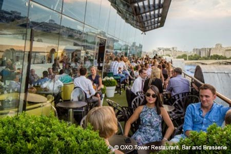 Enjoy a meal on the terrace at Oxo Tower Restaurant Bar & Brasserie, one of GAYOT's Best Outdoor Dining Restaurants in London
