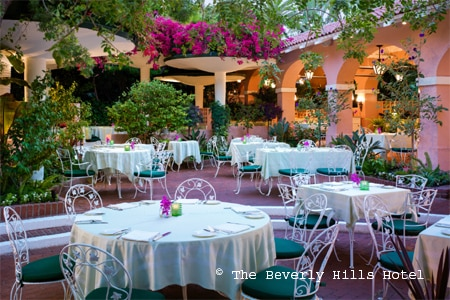 Enjoy a meal on the patio at The Polo Lounge, one of GAYOT's Best Outdoor Dining Restaurants in Beverly Hills & West LA