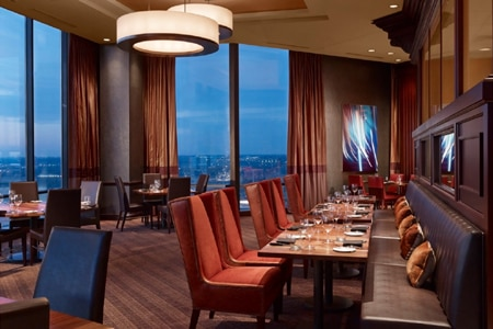 Striking views and tasty beef await at SER Steak + Spirits, one of GAYOT's Top Sexy Restaurants in Dallas/Fort Worth