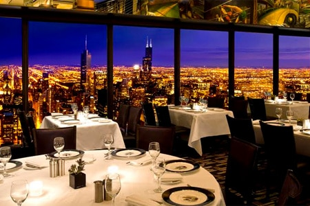 Admire the Windy City from the Signature Room at the 95th, one of GAYOT's Top 10 View Restaurants in Chicago