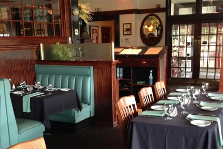 Cozy dining room at the Grist Mill Restaurant, one of GAYOT'S Top 10 Hartford Steakhouse Restaurants