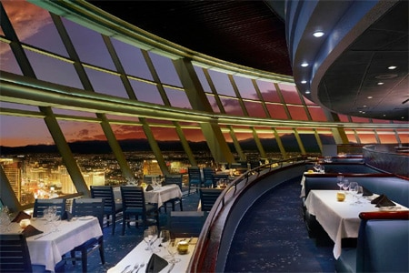 Dine in a dramatic setting with a view and cuisine to match at Top of The World in Las Vegas
