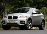 A three-quarter front view of a silver BMW X6