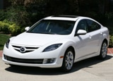 A three-quarter front view of a white Mazda 6