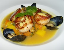 Scallops and mussels in a saffron broth