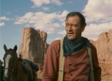 John Wayne in The Searchers, one of our Top 10 Westerns