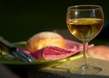 A glass of white wine paired with a dish