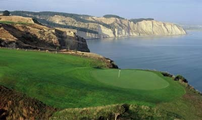 Cliff-side golfing at The Farm at Cape Kidnappers in New Zealand, one of our Top 10 Golf Resorts Worldwide