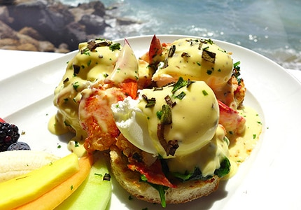 Eggs benedict from Mastro's Ocean Club, one of GAYOT's top restaurant picks for Father's Day