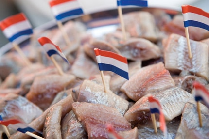 The best street food, available almost everywhere in Amsterdam, is herring and frites (fries)