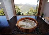The cliff-top spa hot tub at The Lodge at Tarraleah in Tasmania