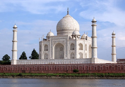 Taj Mahal, a 22-year labor of love from Mugal emperor Shah Jahan to his third wife, is featured in GAYOT.com's Top 10 Must-See Travel Destinations