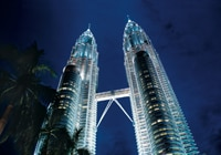 The Petronas Towers rise nearly 1,500 feet above ground