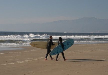 Surfers catching the waves on one of California's scenic beaches