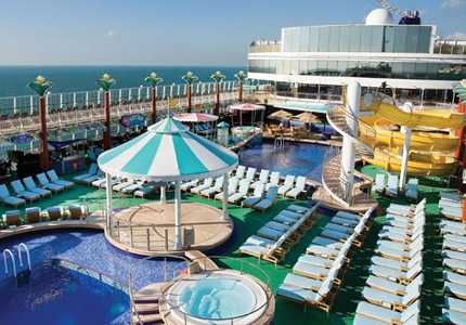 Lay out on the pool deck during your excursion to the Caribbean aboard the Norwegian Gem