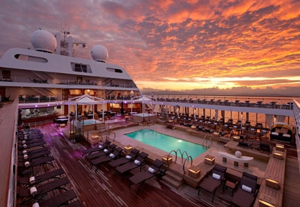 Take a swim in the pool on the top deck of Seabourn's ships