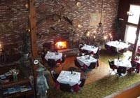 The dining room of the Chateau Belleview features an authentic brick fireplace