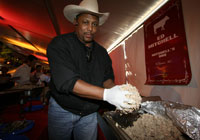 A pitmaster serves a whole pig at BBQ & Blues