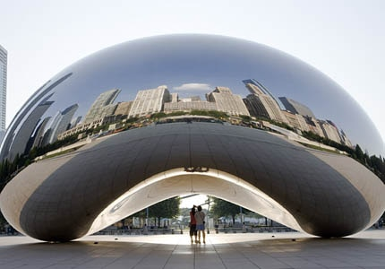 Chicago's skyline reflects from Chicago's Cloud Gate Sculpture at Millennium Park