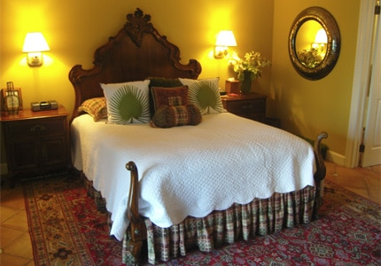 A luxe bedroom at Homestead Inn luxury hotel in Greenwich, Connecticut