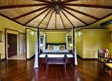 The Nayara Suite has canopy beds, a wrap-around terrace overlooking the Arenal Volcano and a secluded private garden