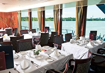 Dining room on Grand Circle Cruise Line's Harmony ship, one of GAYOT's Top 10 Cruise Lines for Specialty Dining