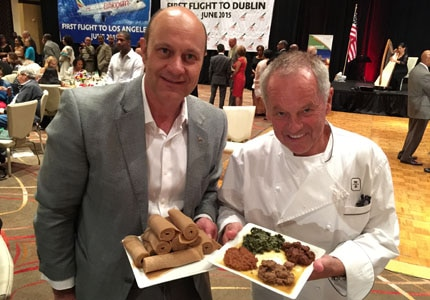 Alain Gayot with chef Wolfgang Puck sampling authentic Ethiopian cuisine
