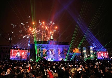 Celebrate with a crowd of roughly two million revelers at Germany's largest open-air New Year's Eve event in front of iconic Brandenburg Gate
