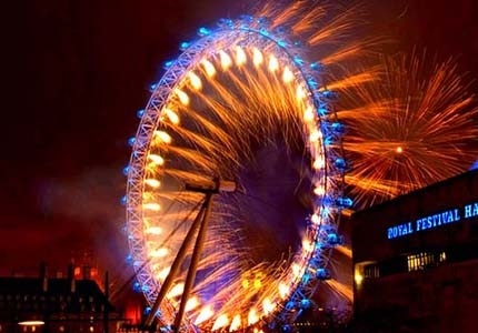 Watch London explode in light and color as fireworks go off over the London Eye and the Thames River for New Year's Eve