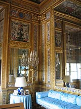 Gilded walls of the interior of Vaux-le-Vicomte in France