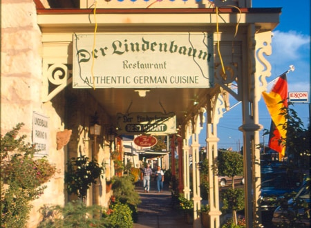 Picturesque view of a street in Fredericksburg with Der Lindenbaum restaurant