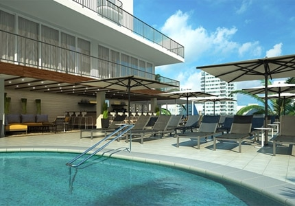 The outdoor heated pool and pool bar on the third-floor sundeck at Hilton Garden Inn Waikiki in Hawaii