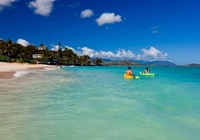 Kayakers enjoy the crystal clear water at Kailua Beach Park in Honolulu