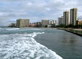 Buildings rising tall above Waikiki Beach in Oahu, Hawaii