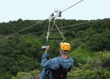 A man rides a zipline, one of the many experiences offered by Kapalua Adventures