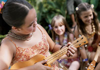 Kids playing ukulele at Camp Hyatt. Find out more in our Hawaii Family Vacation Guide
