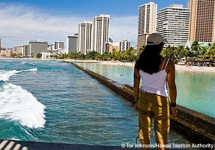 Take in the sights during a walk along the shores of Waikiki Beach in Oahu, Hawaii