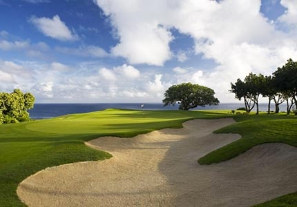 The scenic Hole 13 at The Makai Course at The St. Regis Princeville, one of GAYOT's Top 10 Golf Courses in Hawaii