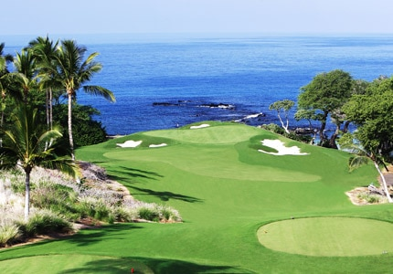 Hole 3 at Mauna Kea, one of GAYOT's Top 10 Golf Courses in Hawaii, overlooks the breathtaking Kamuela shore