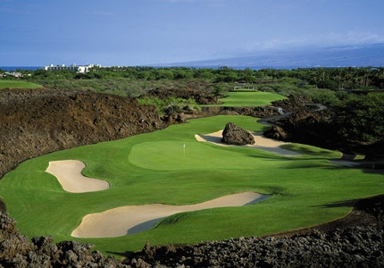 The North Course at Mauna Lani, surrounded by black lava, is one of GAYOT's Top 10 Golf Courses in Hawaii