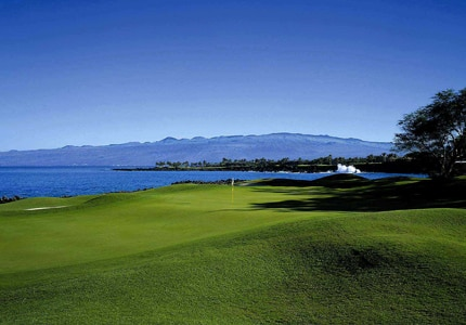 Enjoy scenic views while golfing at Mauna Lani's North Course on the Kohala Coast of Hawaii