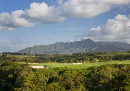 Mountain vistas from the seventh hole on the Prince Course at Princeville Golf Club, one of GAYOT's Top Golf Courses in Hawaii